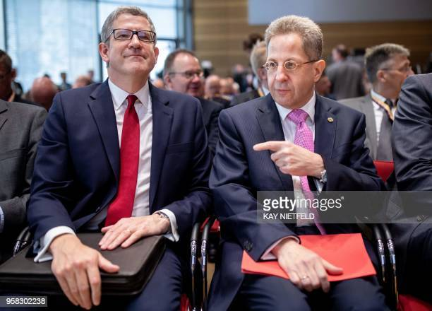 HansGeorg Maassen President of Germany's Federal Office for the Protection of the Constitution points at Andrew Parker DirectorGeneral of the British...