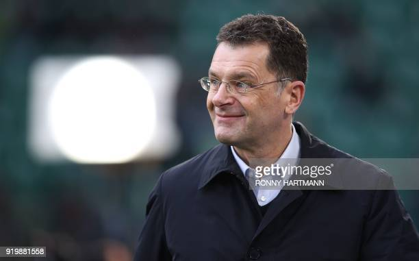 HansGerd Bode Head of Group Communications at German automaker Volkswagen AG enters the pitch prior to the German first division Bundesliga football...