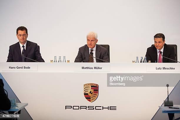 HansGerd Bode head of public relations and media at Porsche AG left Matthias Mueller chief executive officer of Porsche AG center and Lutz Meschke...