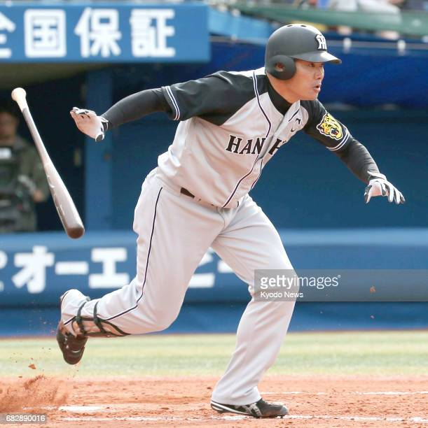 Hanshin Tigers' Kosuke Fukudome hits an RBI single in the ninth inning of a game against DeNA BayStars in Yokohama on May 14 2017 The CentralLeague...