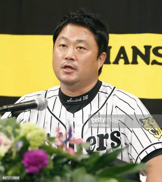 Hanshin Tigers pitcher Yuya Ando attends a press conference in Nishinomiya western Japan on Sept 15 2017 to announce that he will draw the curtain on...