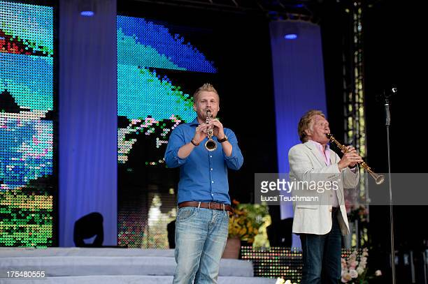 Hansi Arland and Henry Arland perform at the 20 Years Maxi Arland Charity Concert for SOSKinderdorf eV at Optikpark on August 3 2013 in Rathenow...