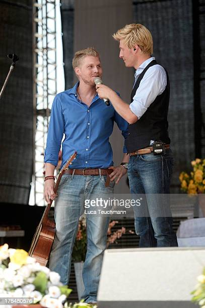Hansi Arland and Maxi Arland perform at the 20 Years Maxi Arland Charity Concert for SOSKinderdorf eV at Optikpark on August 3 2013 in Rathenow...