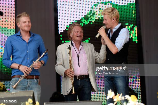 Hansi Arland Henry Arland and Maxi Arland perform at the 20 Years Maxi Arland Charity Concert for SOSKinderdorf eV at Optikpark on August 3 2013 in...