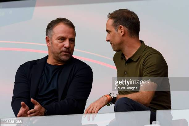 Hansi Flick and Geschaeftsfuehrer Oliver Mintzlaff of RB Leipzig looks on during the Bundesliga match between 1. FC Koeln and RB Leipzig at...