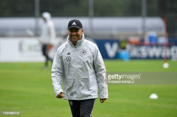 Hansi Flick, new headcoach of Germany's national football team, walks over the pitch during a training session on August 30, 2021 in Stuttgart,...