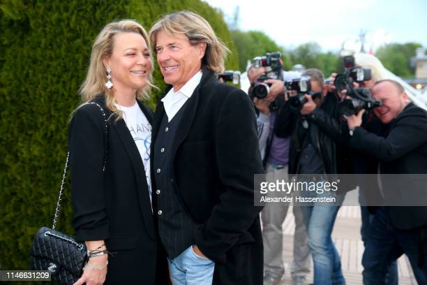 Hansi Hinterseer arrives iwth his wife Romana Hinterseer arrives for the Aufschlag bei Bild Party on day 6 of the BMW Open at MTTC IPHITOS on May 02,...