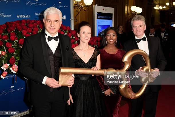 HansJoachim Frey Trixi Steiner Motsi Mabuse and Wolfgang Rothe hold the symbolic key to the Semper Oper as they arrive for the Semper Opera Ball 2018...