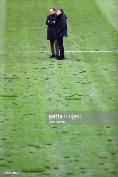 HansJoachim Watzke and Sport Director Michael Zorc of Dortmund inspect the pitch prior to the Bundesliga match between Borussia Moenchengladbach and...
