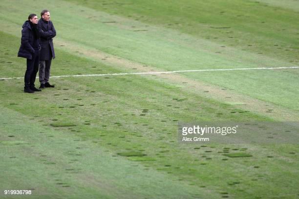 HansJoachim Watzke and Sport Director Michael Zorc of Dortmund inspect the pitch prior to the Bundesliga match between Borussia Moenchengladbach and...