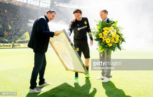 HansJoachim Watzke CEO of Borussia Dortmund together with Director Of Sport Michael Zorn and goal keeper Roman Weidenfeller for his official goodbye...