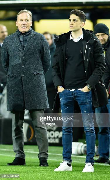 HansJoachim Watzke of Dortmund and Marc Bartra look on prior to UEFA Europa League Round of 16 match between Borussia Dortmund and FC Red Bull...