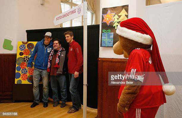 HansJoerg Butt and Holger Badstuber of Bayern Muenchen pose for photographs during a club's Christmas charity initiative at the Bavarian school for...