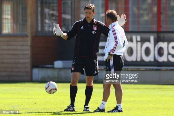 Hans-Joerg Butt talks to assistent coach Franz Huck during the Bayern Muenchen training session at Bayern's training ground 'Saebener Strasse' on...