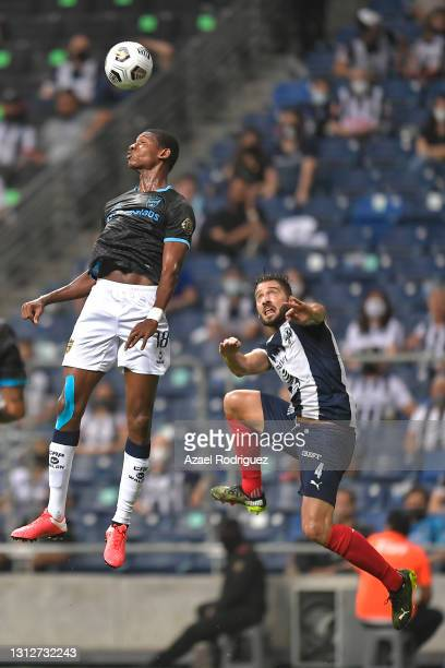 Hansley Martínez of Atlético Pantoja heads the ball while observed by Nicolás Sánchez of Monterrey during a second leg match between Monterrey and...