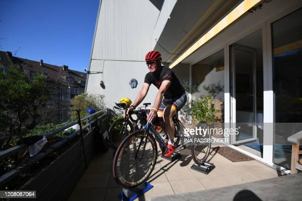 TOPSHOT HansPeter Durst German paracycler of the category T2 trains with his tricycle on his balcony in Dortmund western Germany on March 24 2020 due...