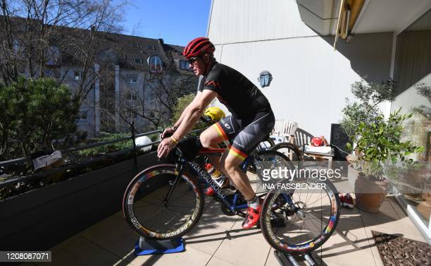 HansPeter Durst German paracycler of the category T2 trains with his tricycle on his balcony in Dortmund western Germany on March 24 2020 due to the...