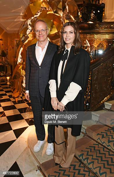 HansUlrich Obrist and Dasha Zhukova attend the Claridge's Christmas Tree Party 2015 designed by Christopher Bailey for Burberry at Claridge's Hotel...