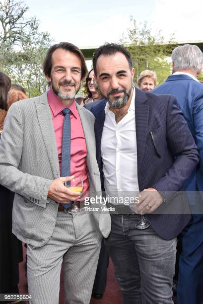 HansWerner Meyer and Adnan Maral during the 45th anniversary celebration of Ziegler Film at Tipi am Kanzleramt on April 27 2018 in Berlin Germany