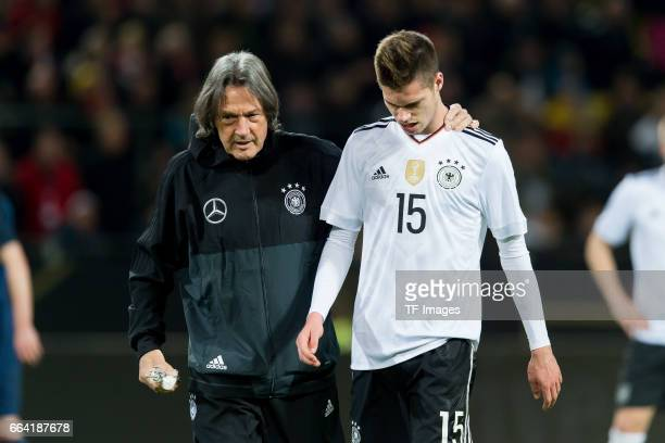 HansWilhelm MüllerWohlfahrt und Julian Weigl of Germany looks on n during the international friendly match between Germany and England at Signal...