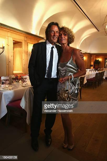 HansWilhelm Mueller Wohlfahrt pose with his wife Karin Mueller Wohlfahrt during HansWilhelm Mueller Wohlfahrts' 70th birthday celebration at Seehaus...