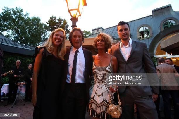 HansWilhelm Mueller Wohlfahrt poses with his daughter Maren De Martino his wife Karin MuellerWohlfahrt and son Kilian MuellerWohlfahrt during the...