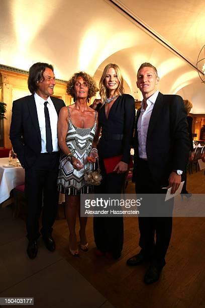 HansWilhelm Mueller Wohlfahrt poses with his wife Karin Mueller Wohlfahrt Sarah Brandner and Bastian Schweinsteiger during HansWilhelm Mueller...
