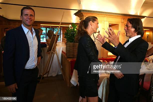 HansWilhelm Mueller Wohlfahrt welcomes Klara Bierhoff and Oliver Bierhoff manager of the German national football team during HansWilhelm Mueller...