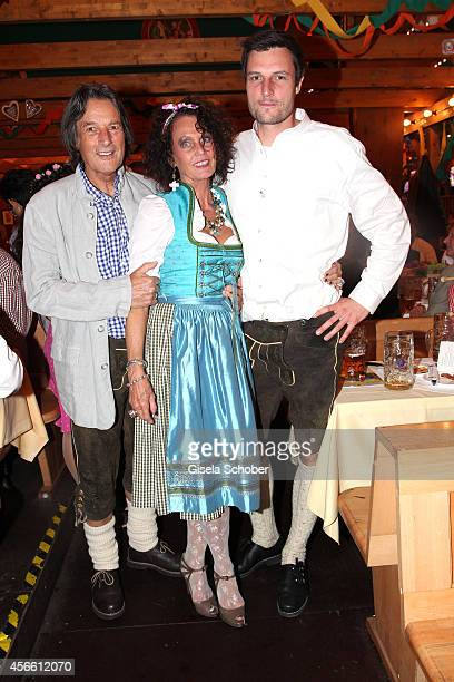 HansWilhelm MuellerWohlfahrt and his wife Karin Mueller Wohlfahrt and their son Dr Kilian Mueller Wohlfahrt during Oktoberfest at...