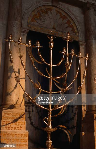 hanukhah lamp in front of marble ark in jewish historical museum. - jewish museum stock pictures, royalty-free photos & images