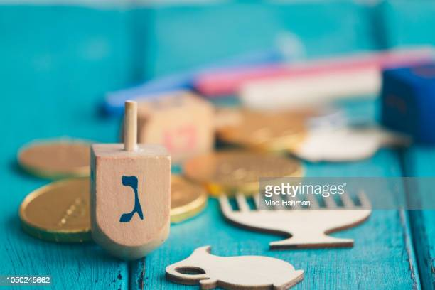 hanukkah celebration composition - dreidel stock photos and pictures
