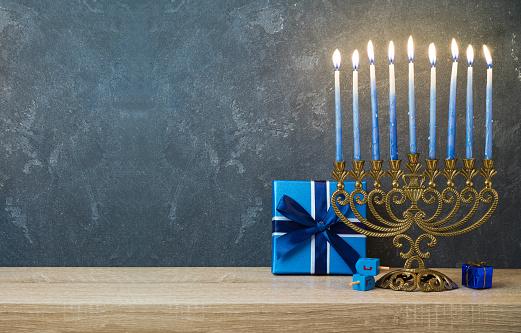 Hanukkah celebration with menorah 868001846
