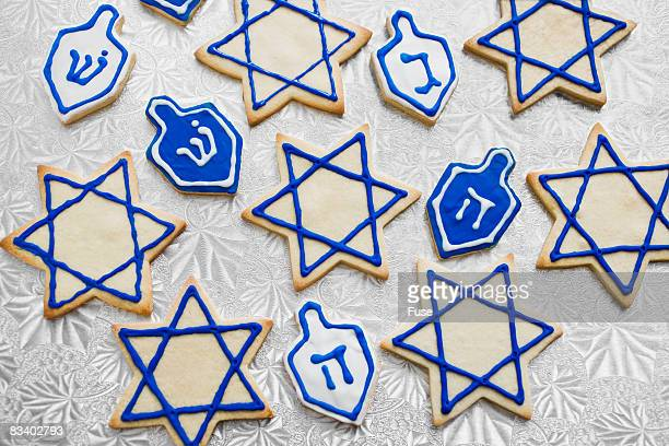 hanukkah cookies - dreidel stock photos and pictures