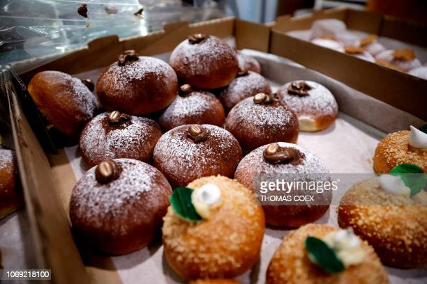 """Hanukkah doughnuts, called """"sufganiyot"""" in Hebrew, are seen for sale at a market in Jerusalem on December 6, 2018. - Consider the doughnut. Good,..."""