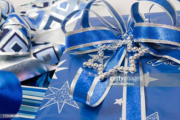 hanukkah gift with blue bow - hanukkah stock pictures, royalty-free photos & images