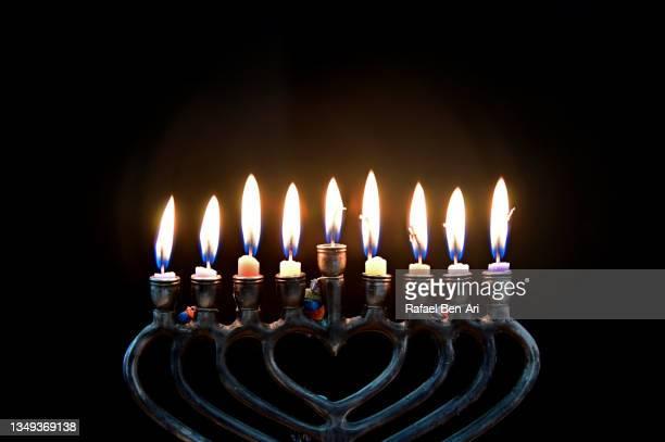 hanukkah menorah with eight candles burning on the eight day of hanukkah jewish holiday - rafael ben ari fotografías e imágenes de stock