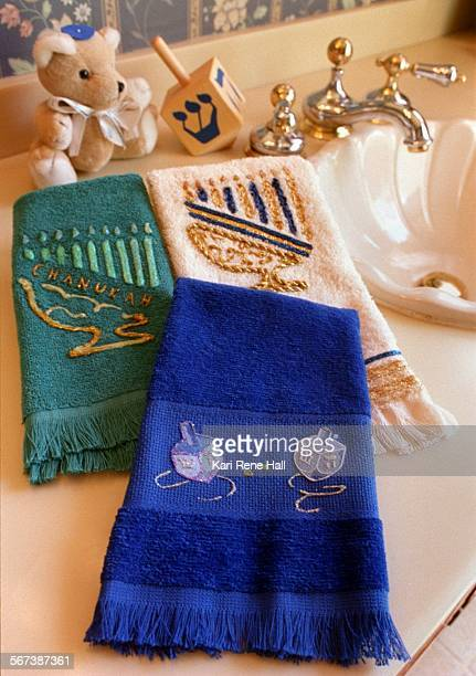 LSHanukkahtowels2KH11/13/95Hand painted fingertip towels by Eileen Notick for Hannukkah ATTN OC PHOTO DESK for Life Style