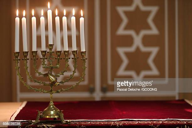 hanukkha with nine lit candles - hanukkah stock photos and pictures
