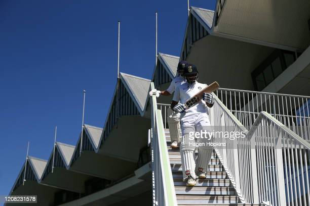 Hanuma Vihari and Ajinkya Rahane of India take the field during day four of the First Test match between New Zealand and India at Basin Reserve on...