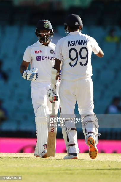Hanuma Vihari and Ravichandran Ashwin of India celebrate during day five of the Third Test match in the series between Australia and India at Sydney...