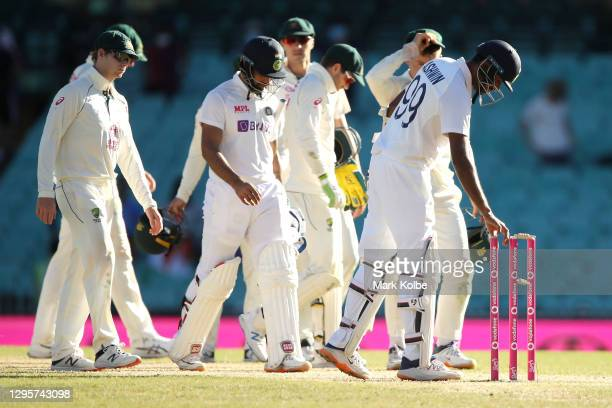Hanuma Vihari and Ravichandran Ashwin of India leave the field after securing a draw during day five of the Third Test match in the series between...