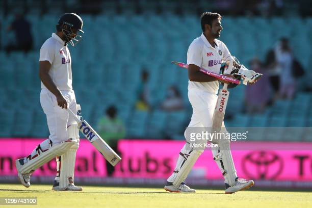 Hanuma Vihari and Ravichandran Ashwin of India leave the field as they celebrate securing a draw during day five of the Third Test match in the...