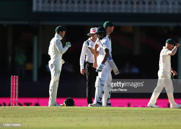 Hanuma Vihari of India and Tim Paine of Australia acknowledge each other after the match ended in a draw during day five of the 3rd Test match in the...