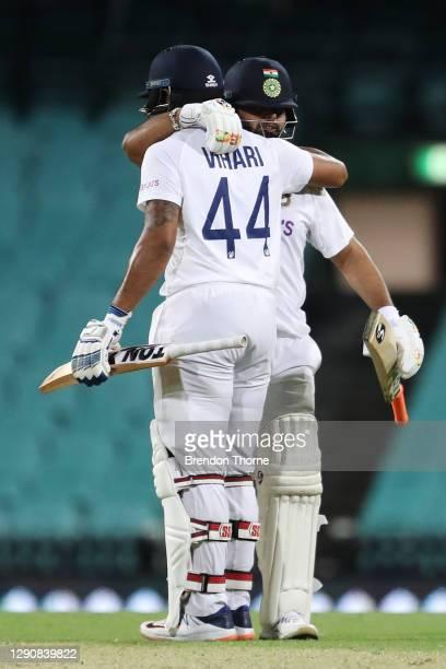 Hanuma Vihari of India celebrates scoring his century with team mate Rishabh Pant during day two of the Tour Match between Australia A and India at...