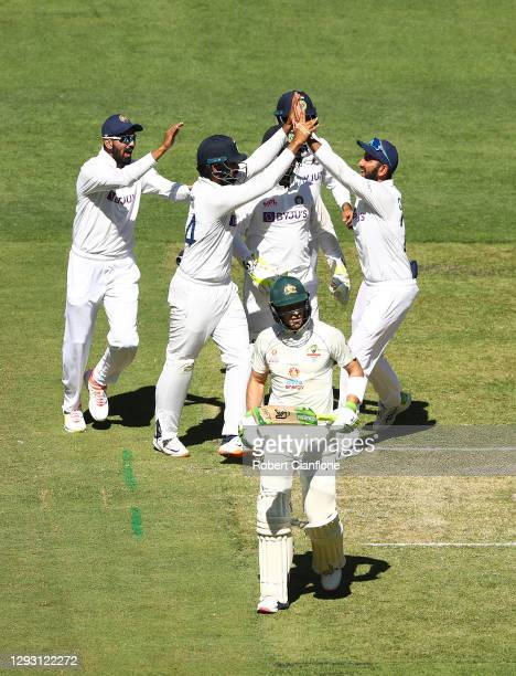 Hanuma Vihari of India celebrates taking the wicket of Tim Paine of Australia during day one of the Second Test match between Australia and India at...
