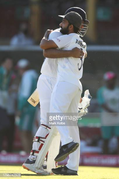 Hanuma Vihari of India embraces his captain Ajinkya Rahane of India as they celebrate securing a draw during day five of the Third Test match in the...