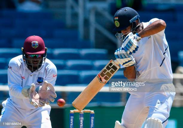 Hanuma Vihari of India hits 4 as Jahmar Hamilton of West Indies watches during day 2 of the 2nd Test between West Indies and India at Sabina Park,...