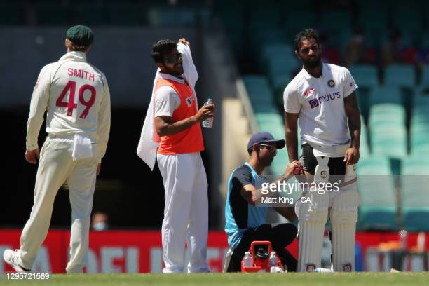 Hanuma Vihari of India is asissted by medical staff during day five of the Test match in the series between Australia and India at Sydney Cricket...