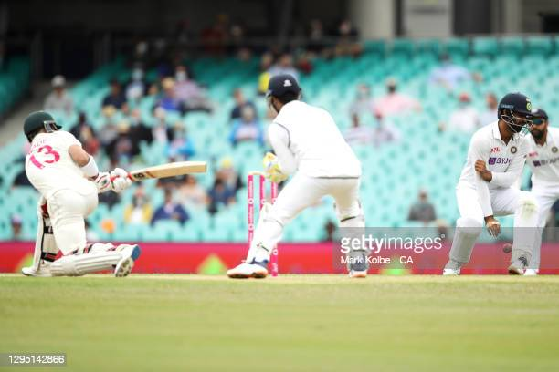 Hanuma Vihari of India is struck with the ball while fielding during day two of the Third Test match in the series between Australia and India at...