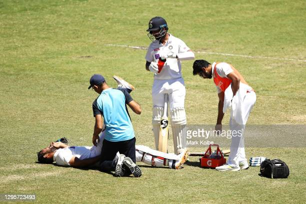 Hanuma Vihari of India receives attention for a leg injury during day five of the Third Test match in the series between Australia and India at...